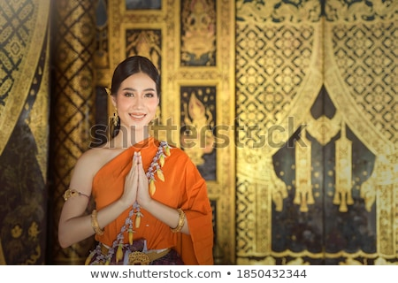 Attractive young Asian woman in traditional dress Stock photo © smithore