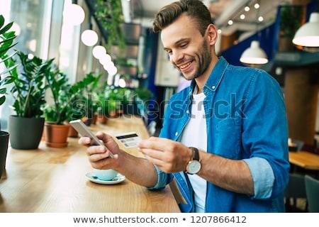 Işadamı cep telefonu kredi kartı portre gülen Stok fotoğraf © Flareimage