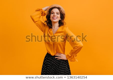 csinos · fiatal · nő · citromsárga · blúz · izolált · fehér - stock fotó © elnur