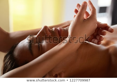 Attractive young woman receiving facial massage at spa center stock photo © wavebreak_media