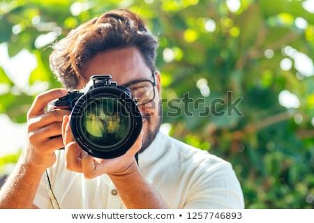 Handsome Indian photographer. Stock photo © ziprashantzi