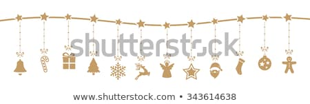 A gingerbread man with a hat and christmas decorations Stock photo © Zerbor