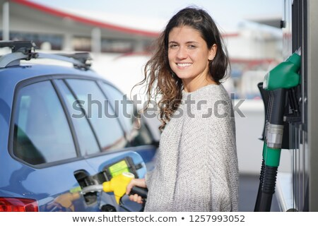 beautiful girl on gas pump station stock photo © aleksangel
