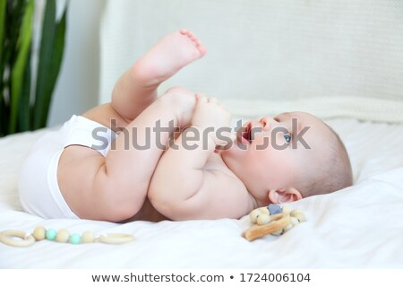 Cute girl lying on a white background Stock photo © BigKnell