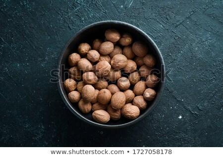küçük · hindistan · cevizi · tohumları · ve · zemin · beyaz - stok fotoğraf © ziprashantzi