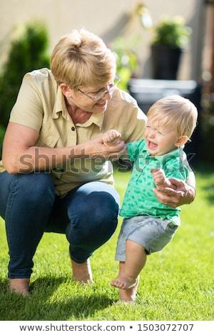 бабушки утешительный плачу внук изолированный белый Сток-фото © szefei