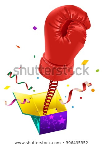 Stock photo: April Fools day. Red boxing glove on spring flies out of box. April Fools joke