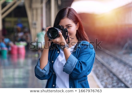 Stock photo: Woman Snapping a Photo