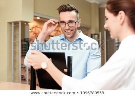 Stok fotoğraf: Optician Client Choose Prescription Glasses