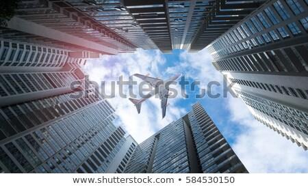 Aeromobili grattacieli volare cielo costruzione città Foto d'archivio © alphaspirit