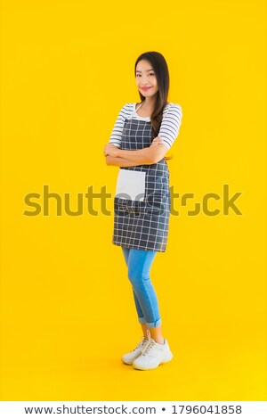A confident woman wearing a yellow uniform Stock photo © bluering