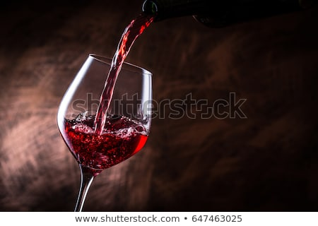 Wine glass with red fruit juice on white Stock photo © tish1