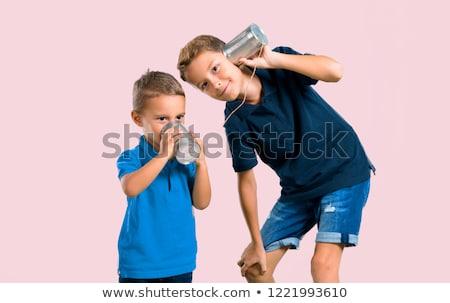 Genç arkadaşlar konuşma kalay telefon erkekler Stok fotoğraf © RAStudio