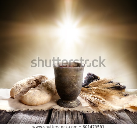 Communion cup with wine and bread stock photo © Iordache