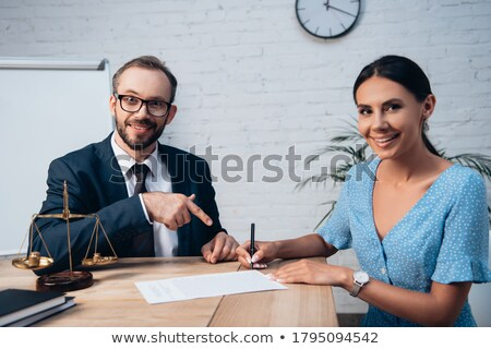 Bearded businessman pointing to camera. Focus on finger. Stock photo © deandrobot