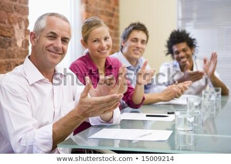Négy üzletemberek tárgyaló tapsol mosolyog boldog Stock fotó © monkey_business