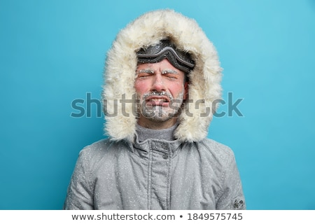 desperate man in hooded jacket is crying stock photo © stevanovicigor