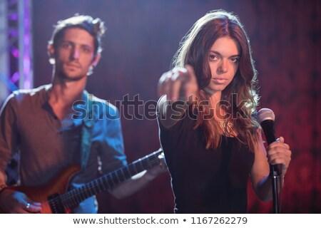 Homme chanteur festival de musique discothèque Photo stock © wavebreak_media