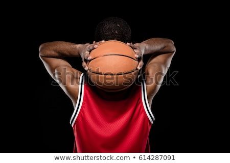 african sporty basketball player in sports uniform on black Stock photo © LightFieldStudios