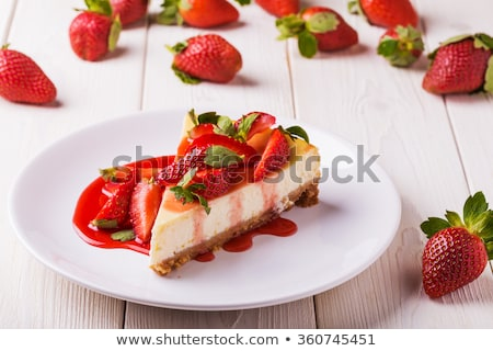 delicious strawberry tart or cheesecake with fresh berries and cream cheese closeup on white wooden stock photo © yelenayemchuk