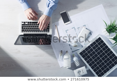 Hand Compact Fluorescent Light Bulbs Solar Panel Stock photo © Qingwa
