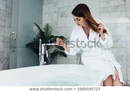Młoda kobieta posiedzenia łazienka domu piękna portret Zdjęcia stock © monkey_business