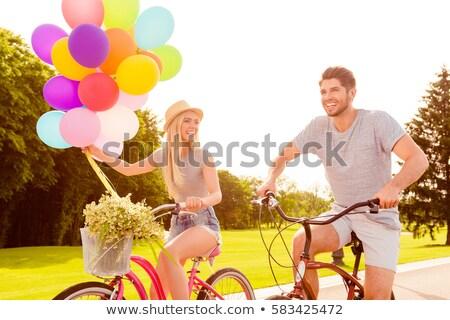 ストックフォト: Happy Girl On Bike With Balloon