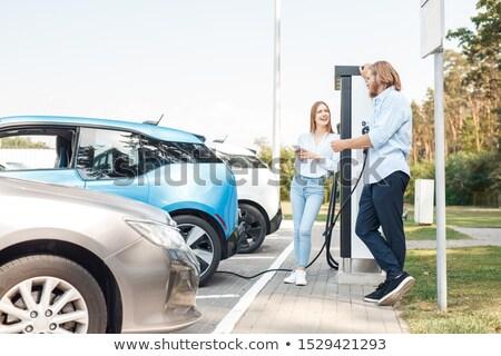 jeune · femme · voiture · électrique · femme · voiture · ville - photo stock © is2