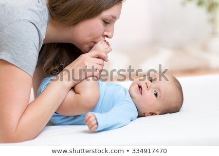 Mother kissing baby's foot Stock photo © IS2
