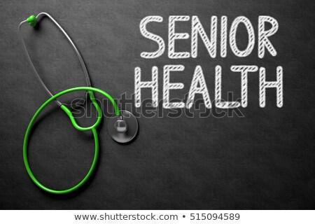 Chalkboard with Senior Health Concept. 3D Illustration. Stock photo © tashatuvango
