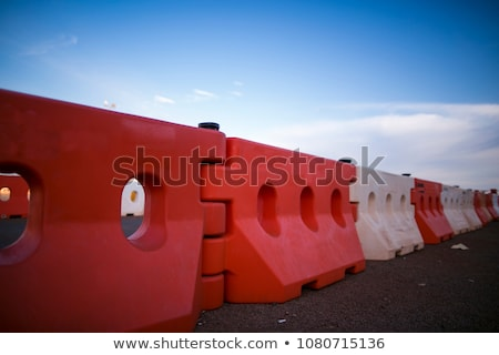 Photo of a line of plastic orange safety barriers Stock photo © Ashnomad