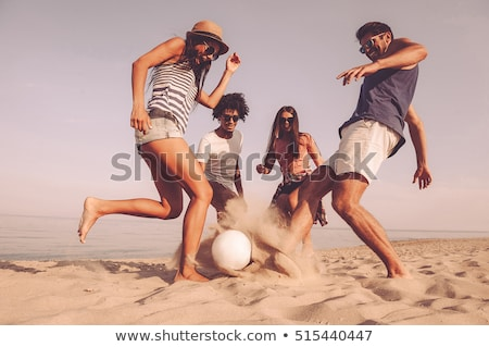 Quatro pessoas jogar bola de praia praia mulher verão Foto stock © IS2