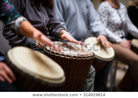 Group of people playing on drums - therapy by music Stock photo © lightpoet