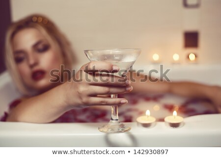 Young girl drinking from the bathroom faucet Stock photo © lightkeeper