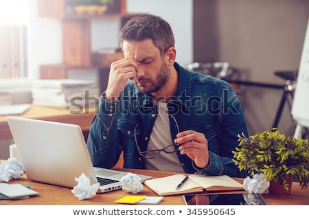 smart casual man sitting and thinking with eyes closed stock photo © feedough