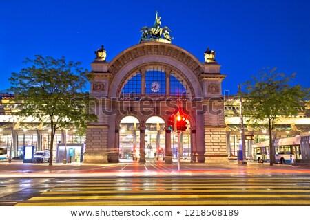 város · öreg · vasútállomás · ív · este · kilátás - stock fotó © xbrchx