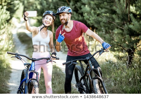 couple with bicycles taking selfie by smartphone Stock photo © dolgachov