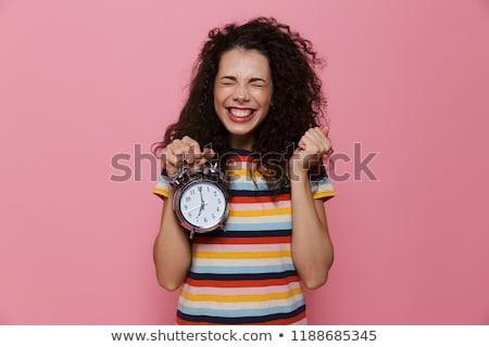 Fotoğraf kadın 20s kıvırcık saçlı çalar saat Stok fotoğraf © deandrobot