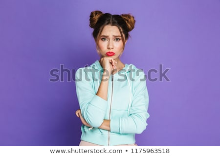 Portrait of upset woman with two buns pouting and looking offend Stock photo © deandrobot