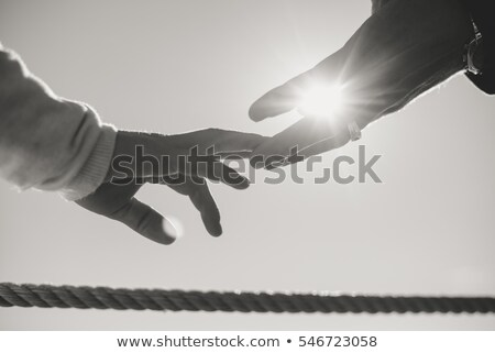 man and womans hand with pair of rings stock photo © andreypopov