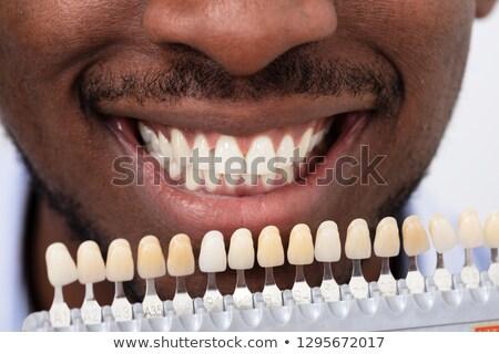 Man ingesteld glimlachend Stockfoto © AndreyPopov