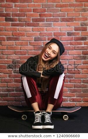 Kép csinos sportos lány 20-as évek nevet Stock fotó © deandrobot
