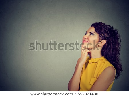 Lovely beautiful girl looking up Isolated on gray background Stock photo © studiolucky
