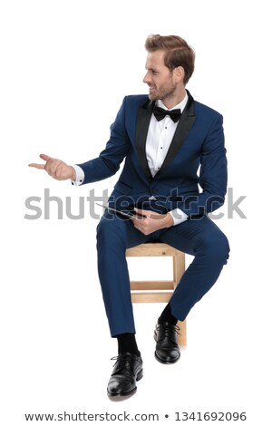 handsome man questioning while holding a notepad in his hand Stock photo © feedough