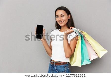 mutlu · genç · kadın · cep · telefonu · tam · uzunlukta - stok fotoğraf © deandrobot
