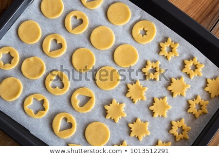 Cutting out star shapes for traditional Linzer Christmas cookies Stock photo © madeleine_steinbach