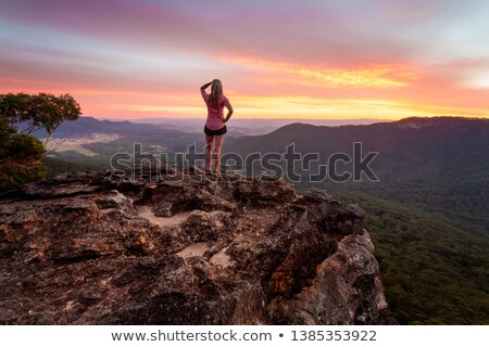 female watching the sunset after a long day hiking in blue mountains stock photo © lovleah