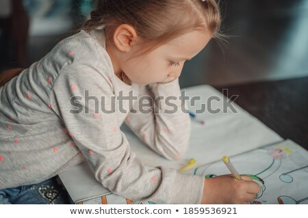Serious girl coloring picture Stock photo © pressmaster