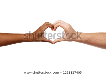hands of different skin color making heart shape Stock photo © dolgachov