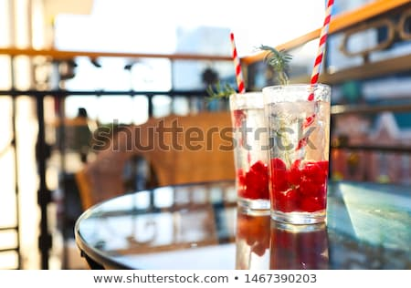 Summer refreshing lemonade with rasberry on a balcony of terrace Stock photo © dashapetrenko